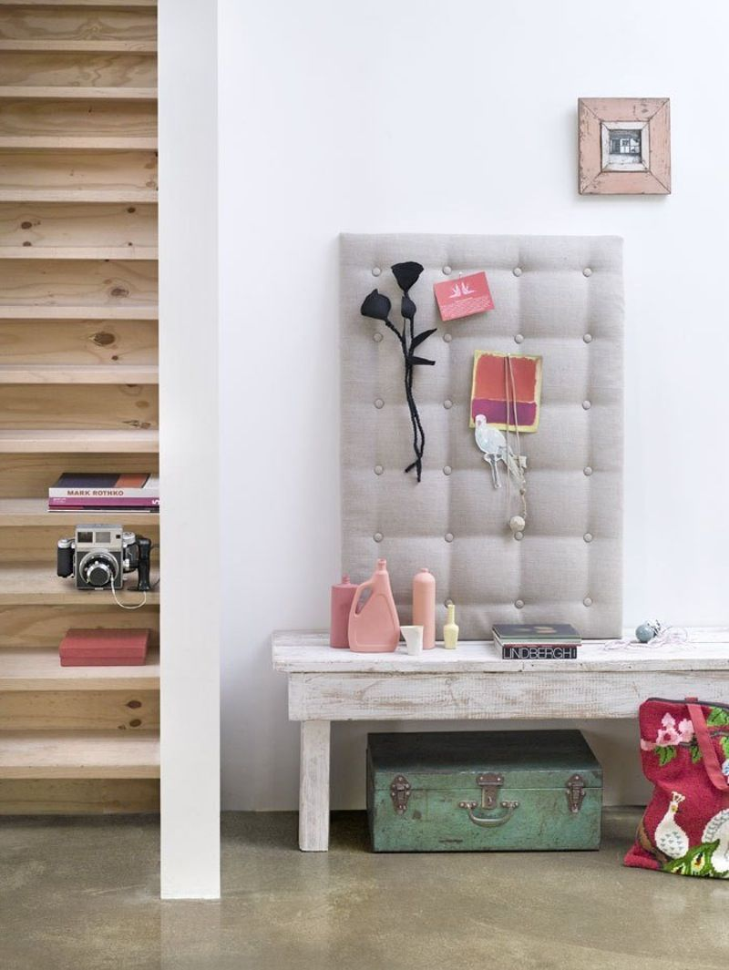 tufted fabric pinboard in entyrway, staircase, and bench