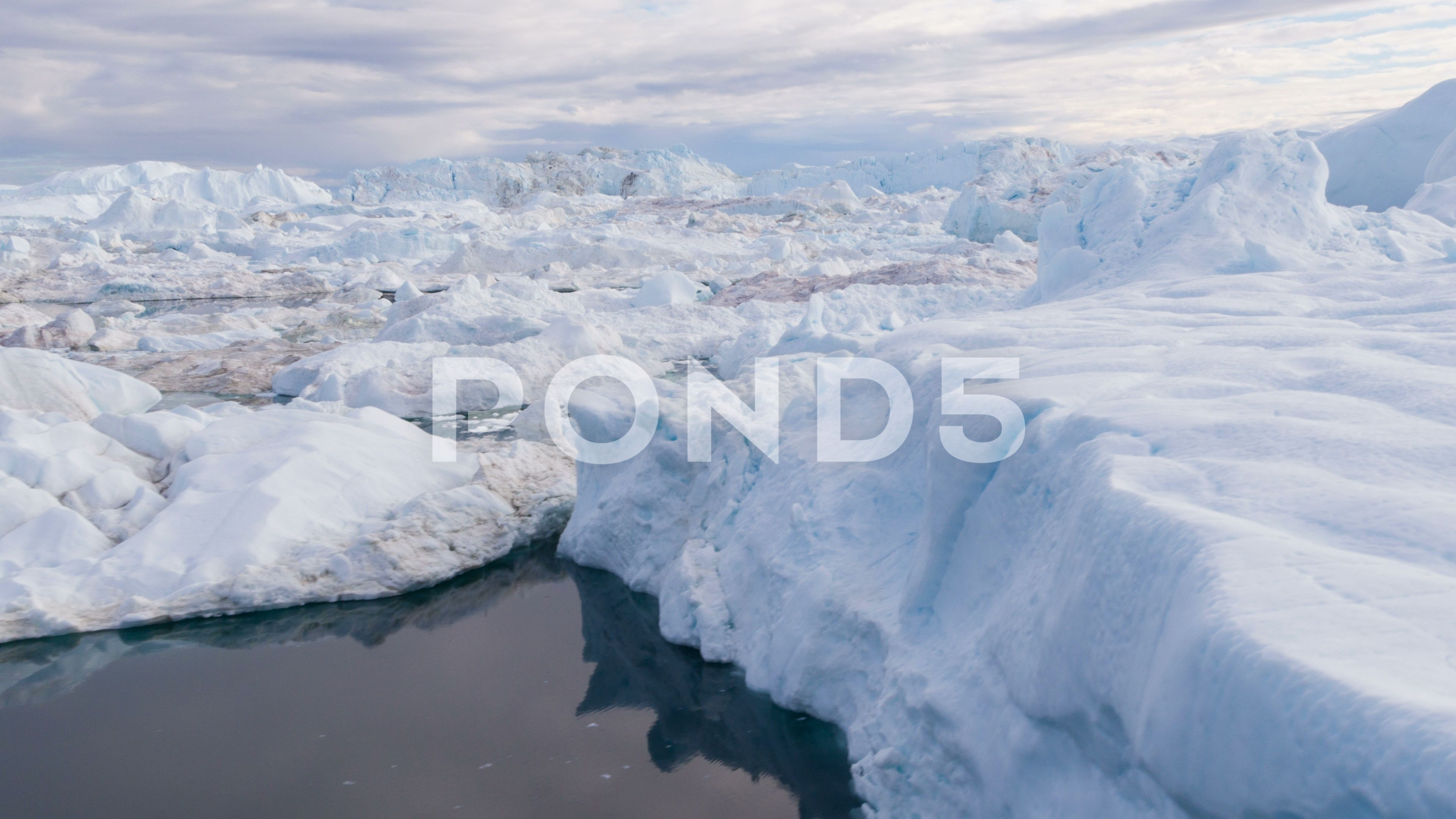 Iceberg from glacier in arctic nature landscape on