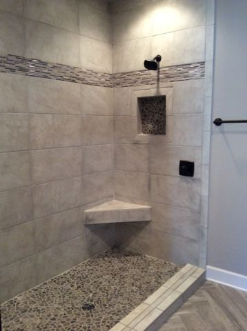 florim suburb westwood shower wall tile with decorative banding and pebble inlay and shower floor