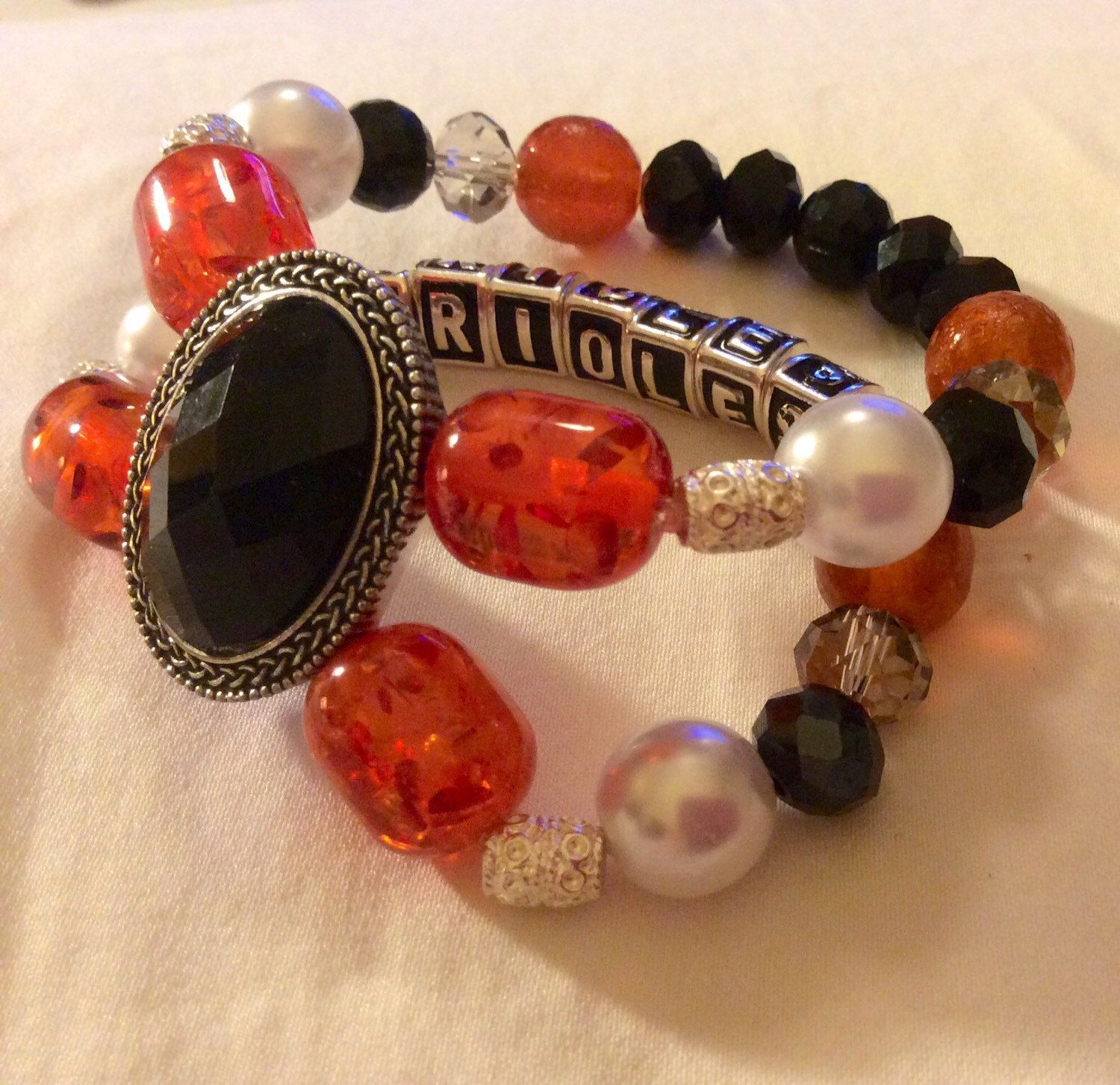 A personal favorite from my Etsy shop https://www.etsy.com/listing/224173774/baltimore-orioles-baseball-jewelry