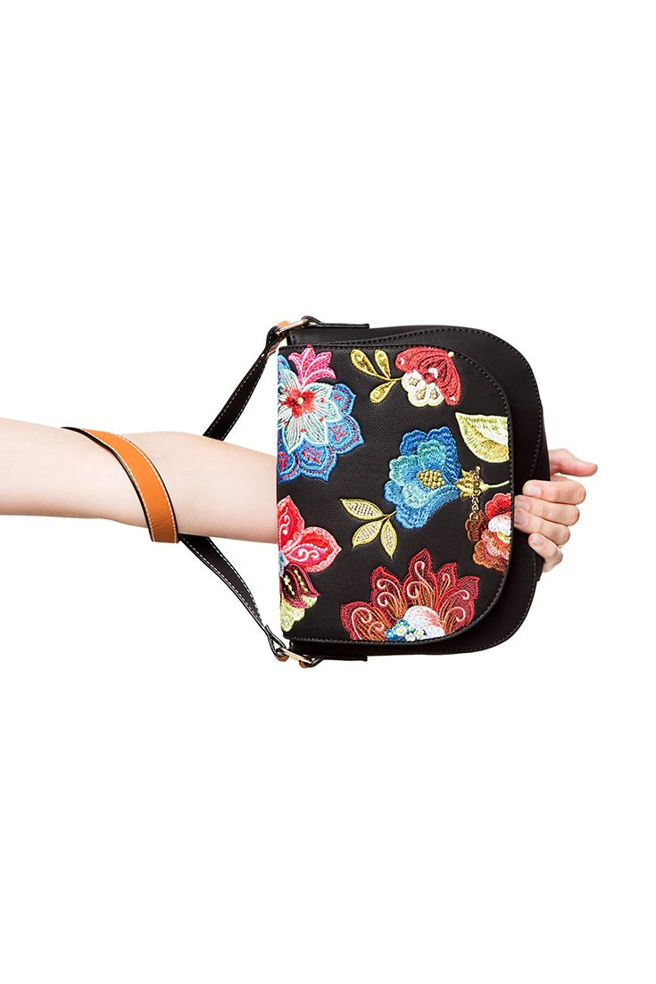 b404fdddfb Desigual faux leather black messenger bag with embroidered flowers and a  magnetic fastening. Take a