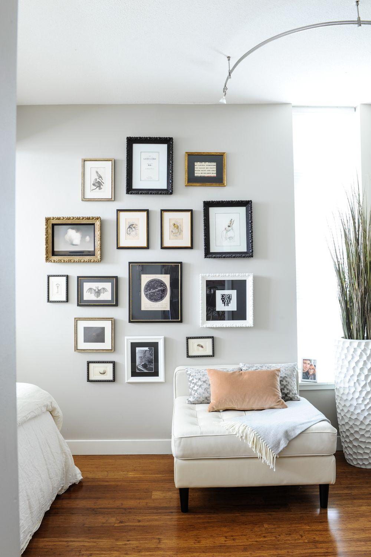 Bedroom gallery wall in beautiful apartment. Grey walls, wood floor ...