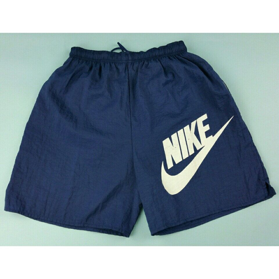 b02be94c8ed These Vintage 90s Nike shorts are still up for grabs. Swing by  JustOneVintage.com and pick up these swim trunks. #JustOneVintage