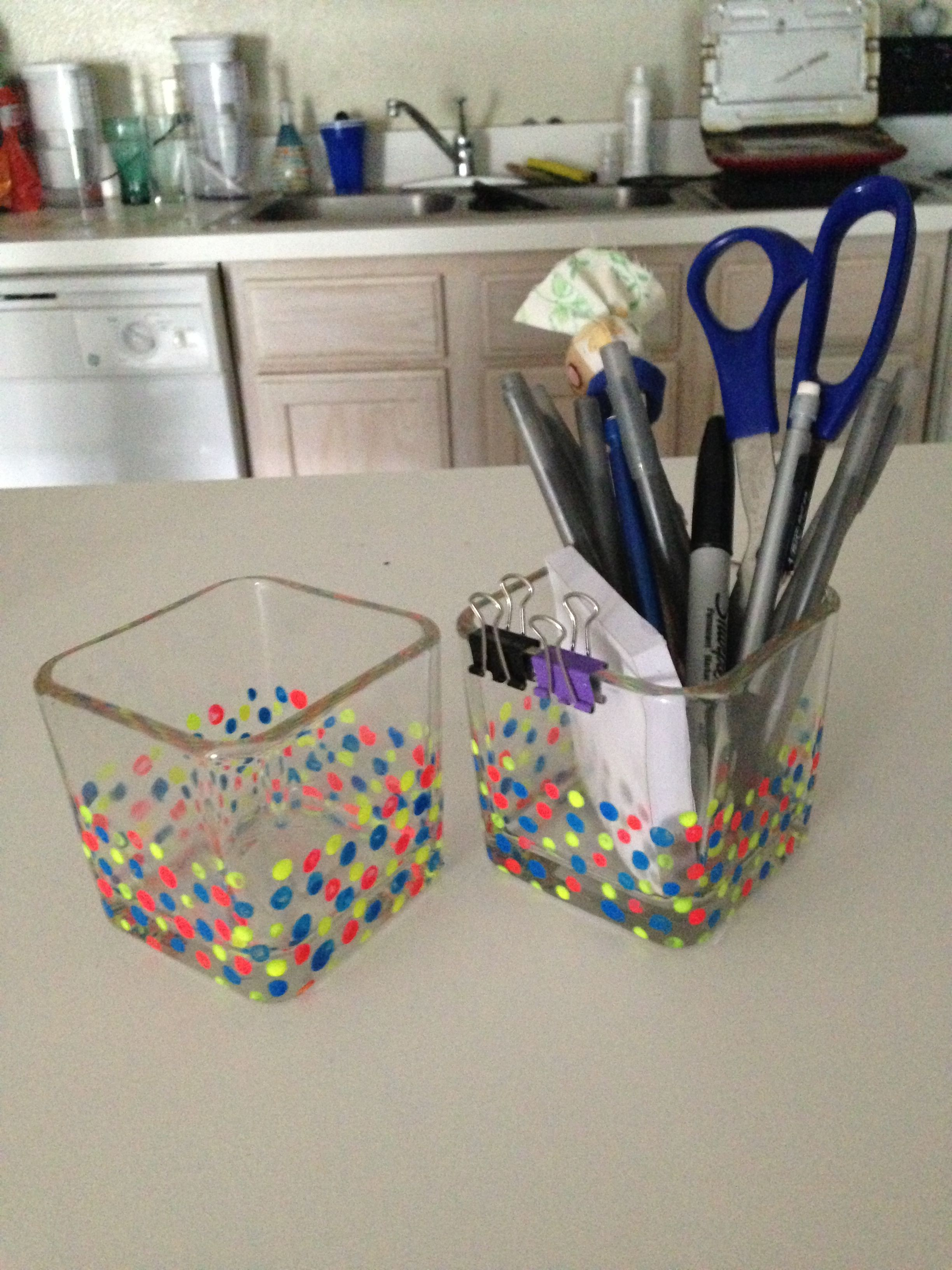DIY pencil holders using dollar store vases and q-tips to paint.