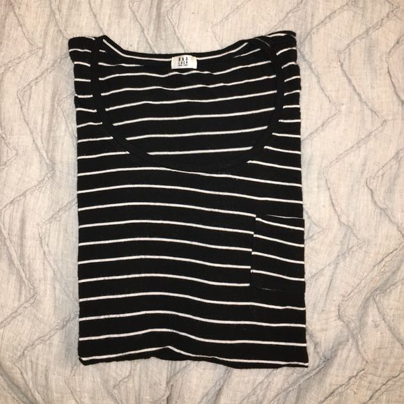 Brandy Melville Scoopneck Tee Scoop neck short sleeve t-shirt with mini pocket detail on the left. Small slits at the bottom of both sides. Worn once and in perfect condition! Black and white stripes. Brandy Melville Tops Tees - Short Sleeve