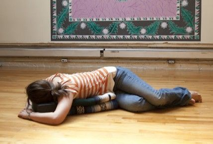 restorative yoga poses this is a reclined supported twist