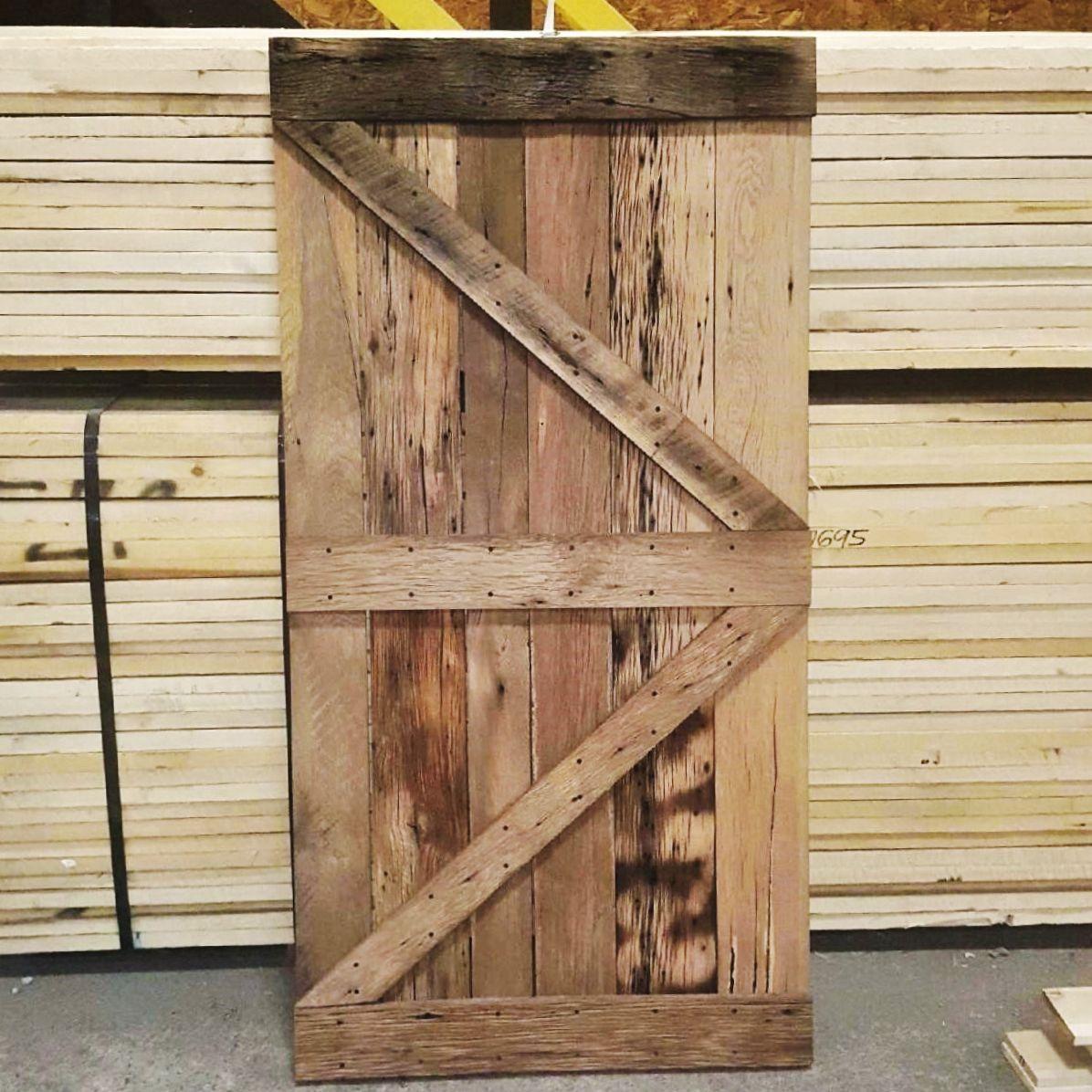 Reclaimed Wood Barn Door Made By 84 Lumber Custom Millworkshops Barn Door Wood Barn Door Interior Sliding Barn Doors