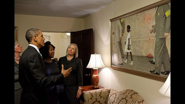President Obama looks at this Norman Rockwell painting of forced school integration with the painting's subject, Ruby Bridges.  (Thanks to @dengre at Balloon Juice)
