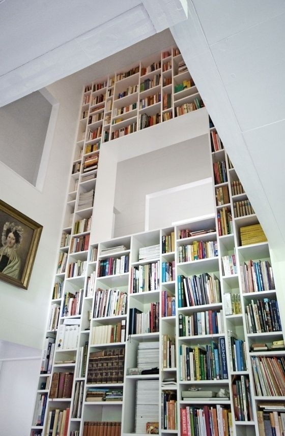 35 things to do with all those books i will admit to employing i love this floor to ceiling bookcase i mean it would be cool to have a built in reading area in the bookcase where that white thing is solutioingenieria Choice Image