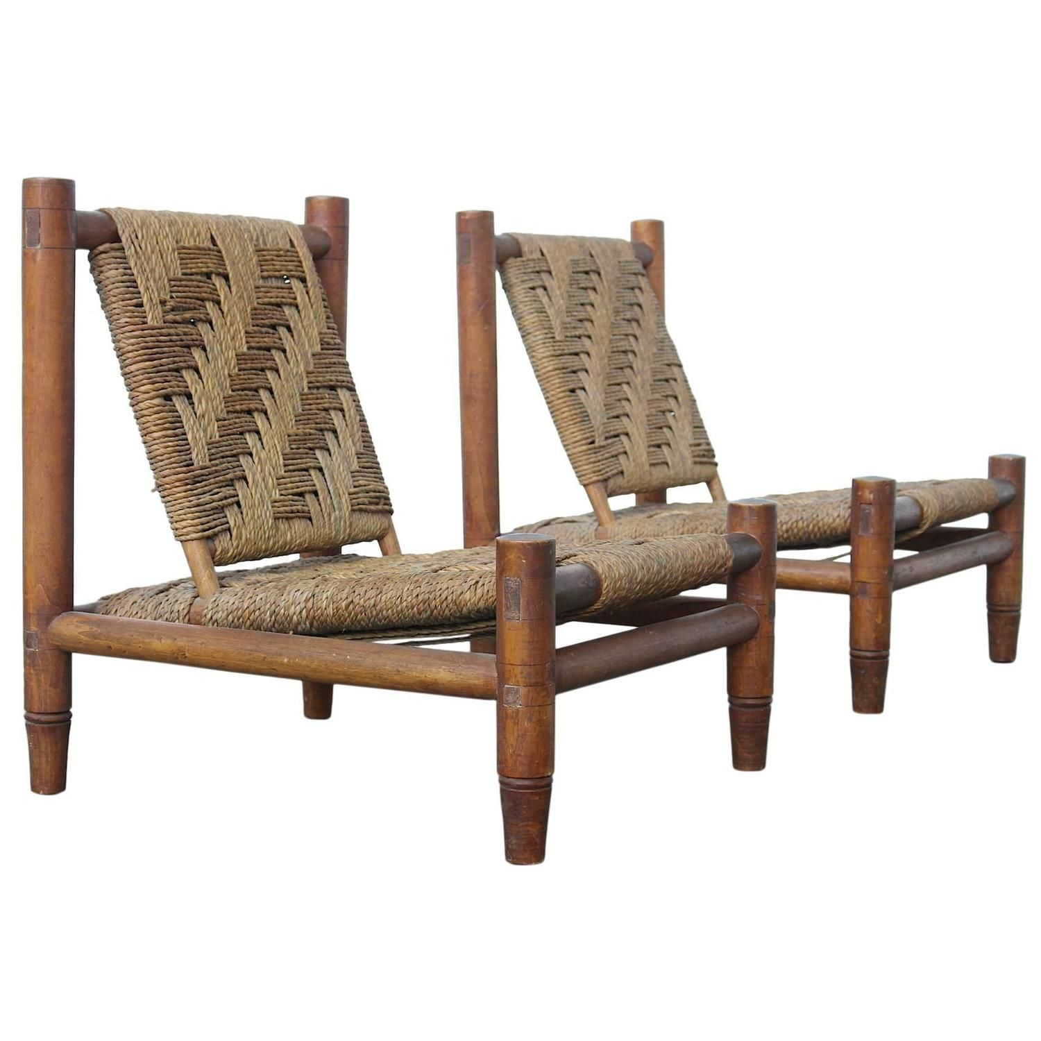 Pair of Rare French 1950s Charlotte Perriand Style Easy Chairs | See more antique and modern Lounge Chairs at https://www.1stdibs.com/furniture/seating/lounge-chairs