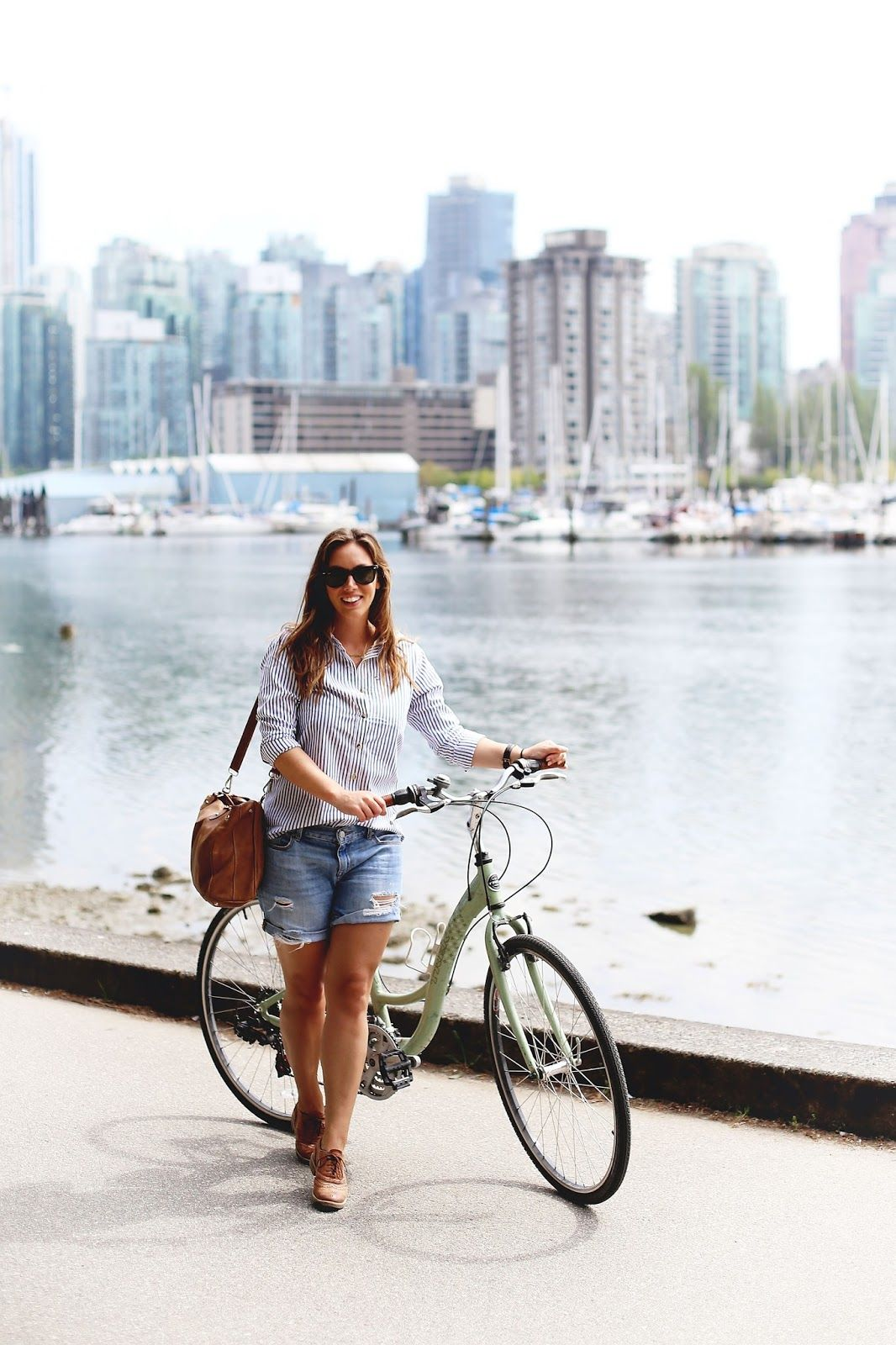 How to bike in style // Denim cut-off shorts, striped oxford shirt, cross-body bag, brogues. #style #fashion #bike #vancouver