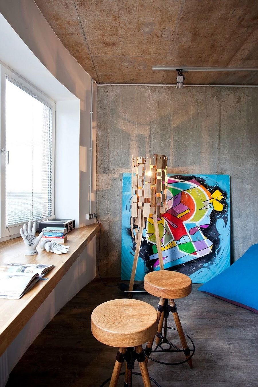 Gorgeous floor lamp and colorful art work add character to the interior decoist