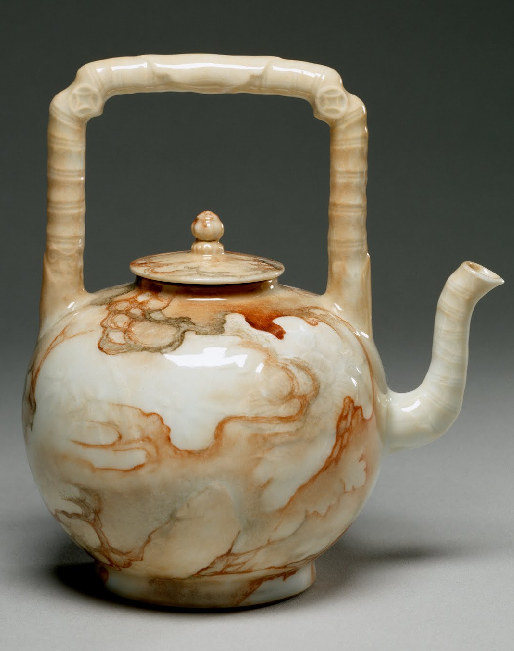 Teapot, Chinese 1736-1795  The body of the vessel was made in a mold that formed chrysanthemums in low relief; then it was decorated with a marblized pattern within which there is actually a landscape, with mountains, trees, and mist. Here a landscape lies within a teapot painted to look like marble.  The Walters Art Museum
