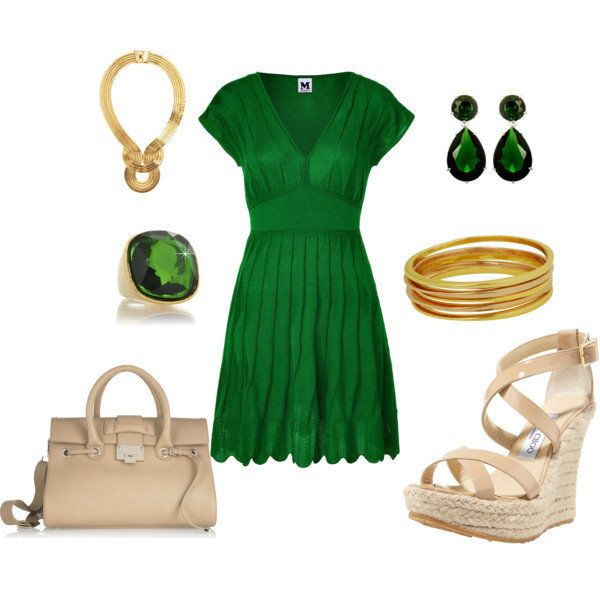 Emerald green dress with gold accessories.