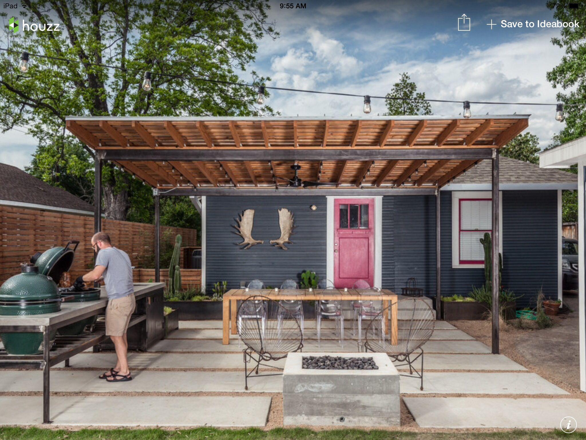 Backyard modern wooden pergola, green egg BBQ grill with ...