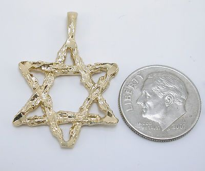 Star of David New Pendant Gold Charm  Mine looks more like golden twigs and has that vintage gold look to it because I've had it for many years.
