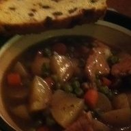 Crockpot Guinness Stew w/ Irish Soda Bread.   22 ounce of Guinness,  2 cups frozen peas, 2 cups chopped carrots, 1 pound of potatoes, thyme, rosemary,1 large onion and 2 large garlic gloves.  I substituted pork for lamb.(1lb cubed).  Cook on high for 5 hrs.  Add potatoes after the 3rd hour.