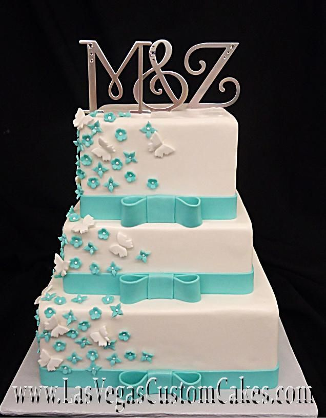 Turquoise Ribbon And Erflies Wedding Cake
