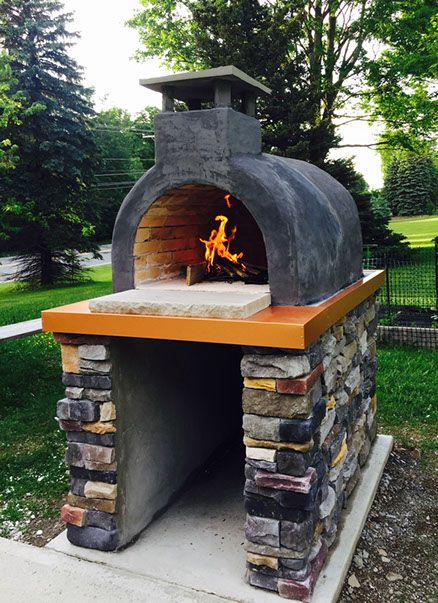 Wood Fired Brick Pizza Oven With Stucco Coloring And Natural Stone