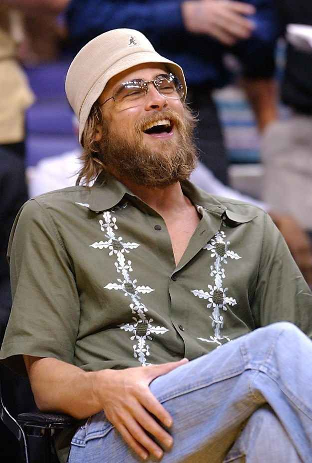 Brad Pitt s Kangol bucket hat and embellished button down.  36d06a9c74f