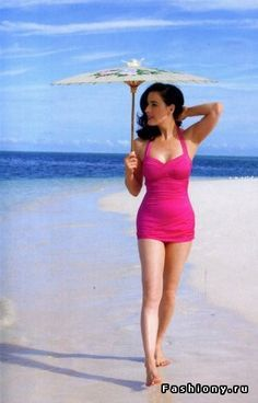 bcb4f53daf5 Glamorous Starlet Swimsuit Wardrobe... Dita Von Teese in a pink one piece  on the beach... with a parasol