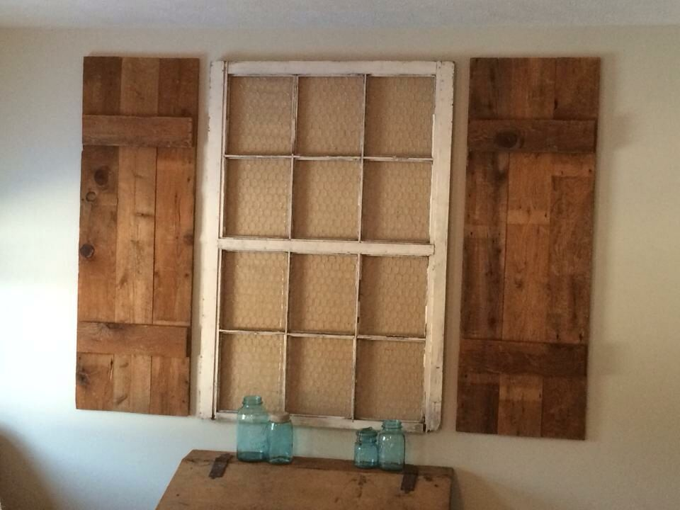 Repurposed 12 pane window with chicken wire and burlap and custom barn wood shutters