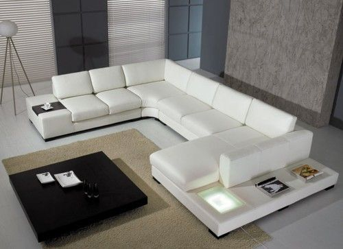 Divani Casa T35  Modern Leather Sectional Sofa with Light is part of Traditional Living Room Sectional - Description Award winning design Armrest ledge for drinks Light on the side that plugs in to an outlet Wooden block legs Low profile contemporary sleek look Coffee table available Real leather where your body touches, high quality leather match material on the back May be ordered in different leather & fabric colors (Special Order) Sofa with end table W65'' x D38  x H30'' Corner W45'' x D45  x H30'' Armless sofa W56  x D38  x H30'' Chaise with end table W53'' x D75  x H38''