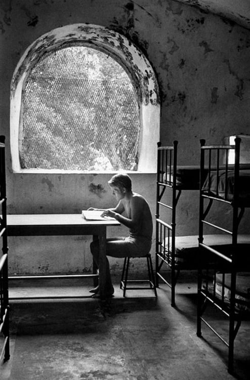 André kertész young man seated near window martinique 1972