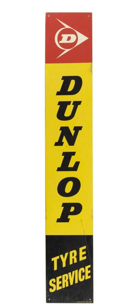 Dunlop tyre service advertising panel of yellow tin, with 'DUNLOP' printed in black in the centre, the Dunlop logo in white on red at the top, and 'TYRE SERVICE' in yellow on black at the bottom of the sign, c. 1962