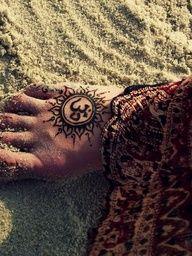OM henna tattoo.