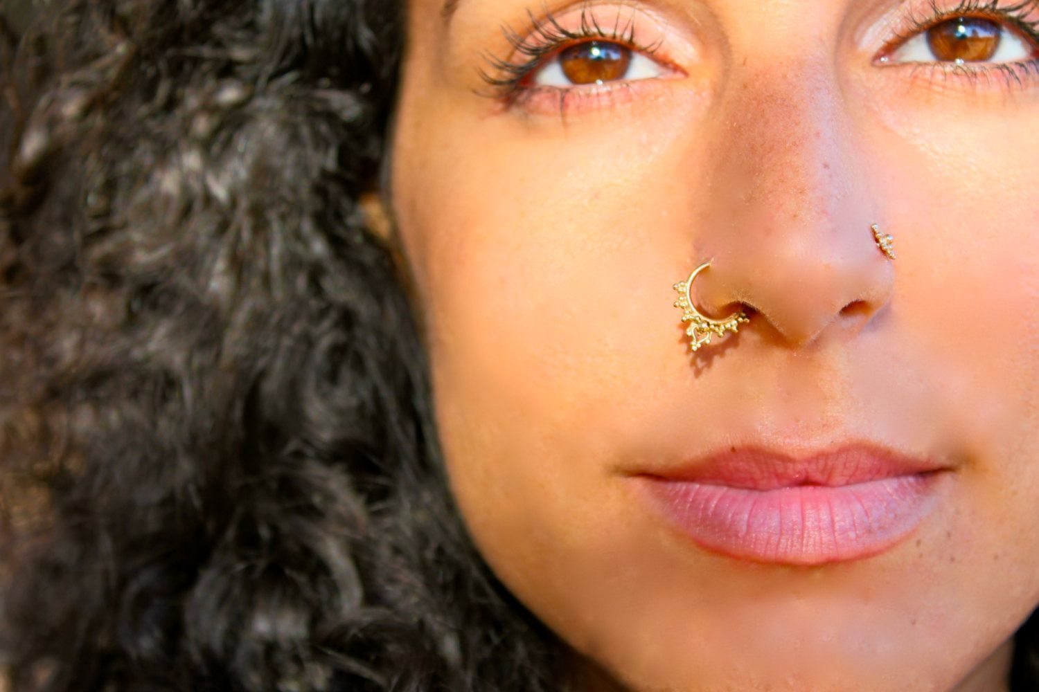 Nose piercing through both nostrils  Lalita Silver and Gold septum nose ring Body by BeleafJewelry