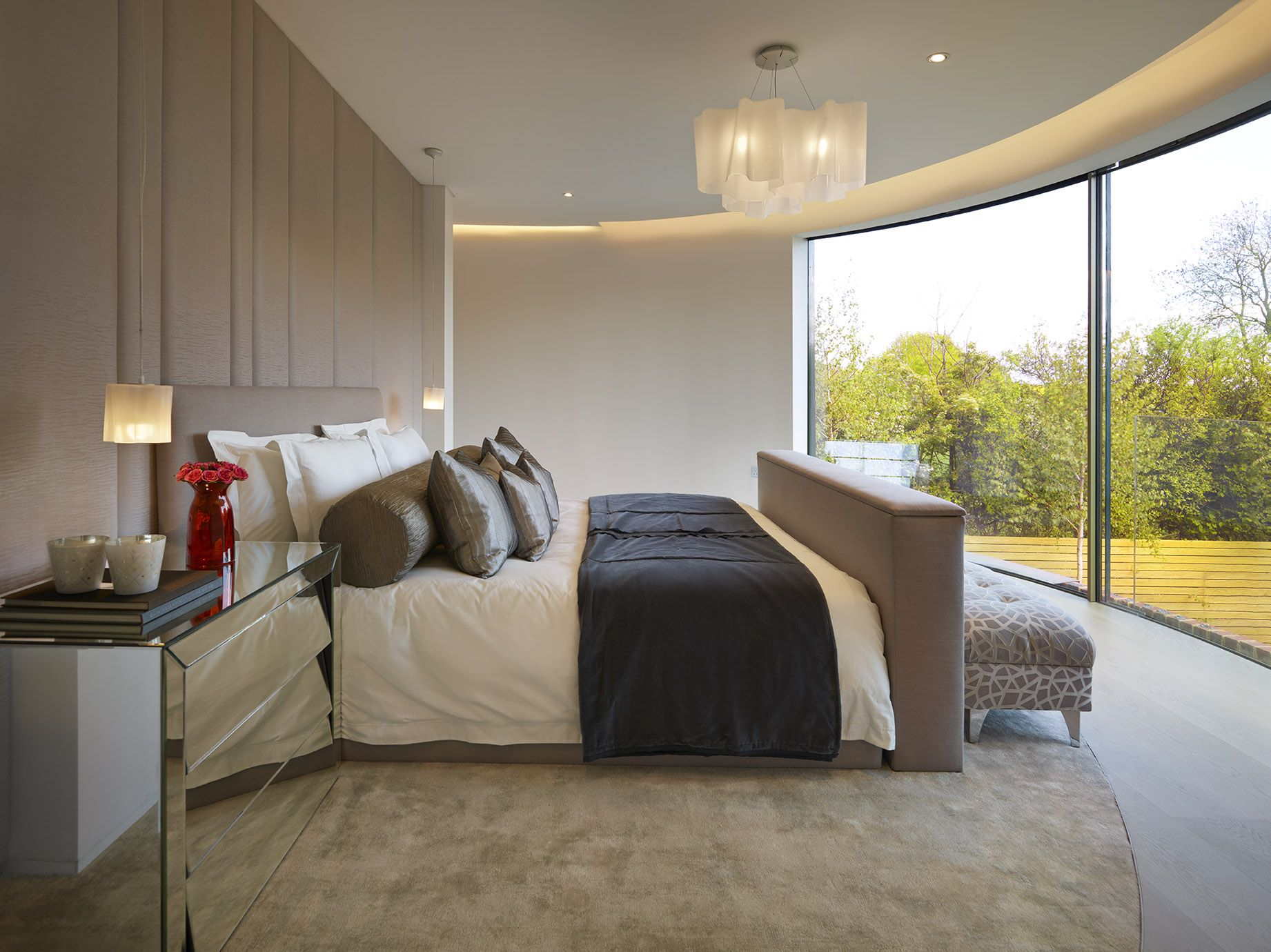 Master bedroom in the kiln with curved glass wall