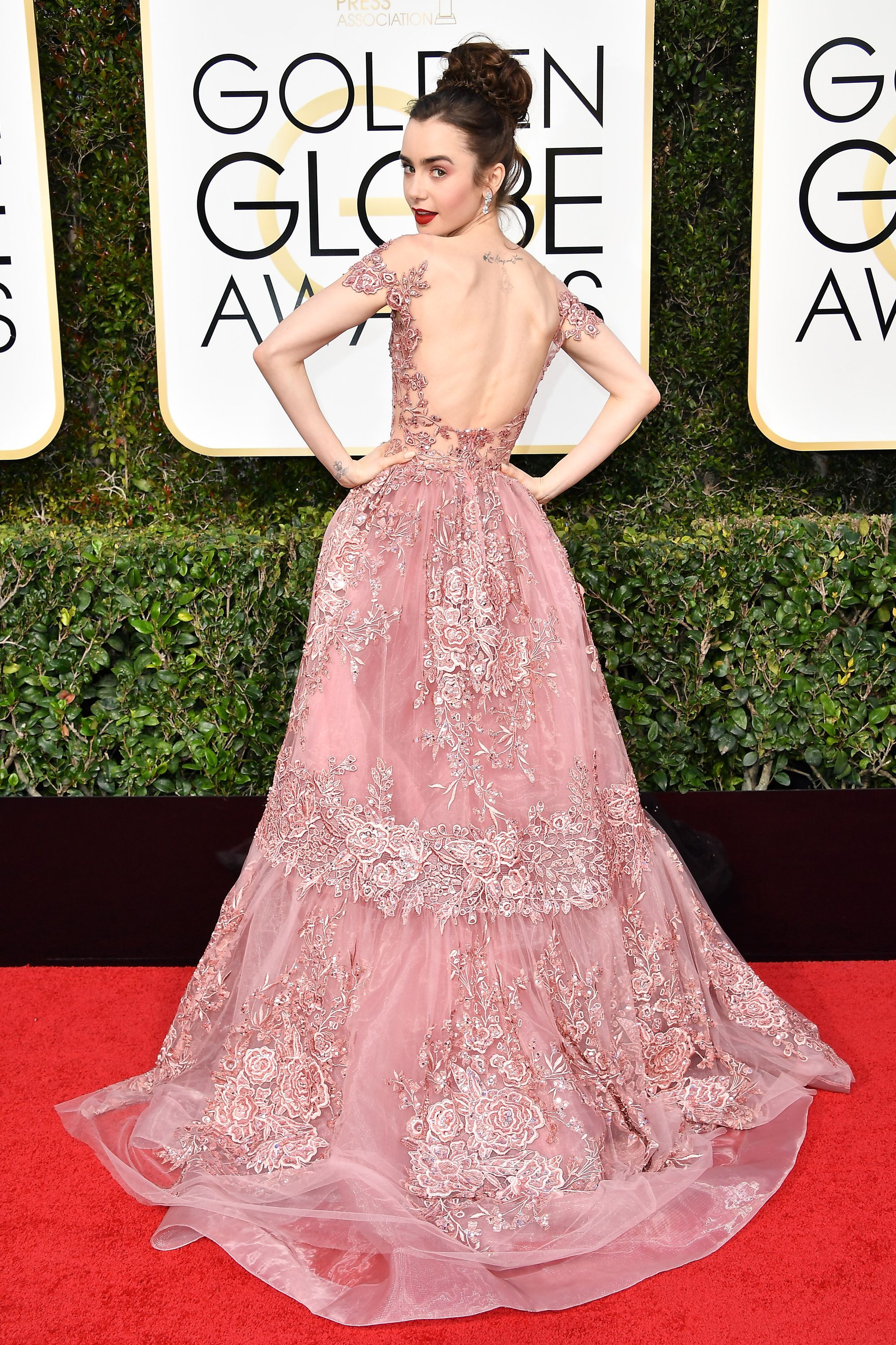 Whimsical Beauty on the Red Carpet: Lily Collins magically appeared straight out of a fairytale storybook at the 2017 Golden Globes, in a romantic, dusty pink-rose colored Zuhair Murad ball gown.