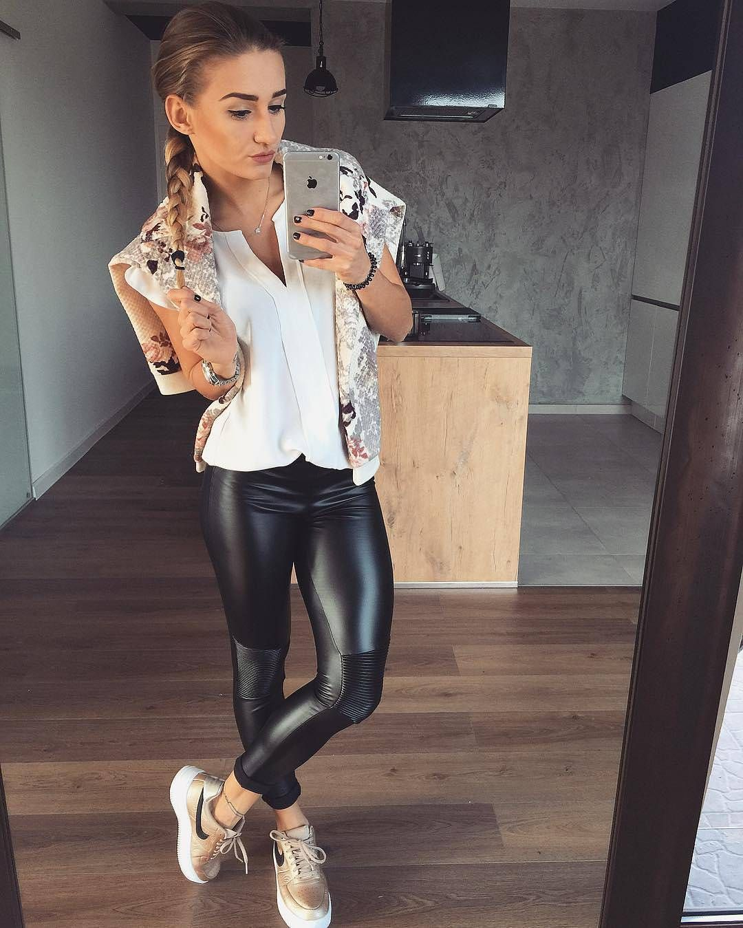 sleek black faux leather leggings worn with white blouse. Black Bedroom Furniture Sets. Home Design Ideas