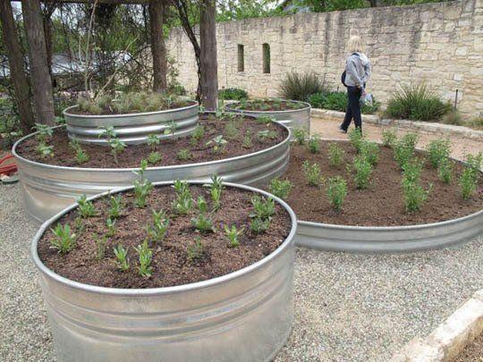 5 Ways To Use Galvanized Stock Tanks As Planters Stock Tank Gardening Galvanized Stock Tank Veggie Garden