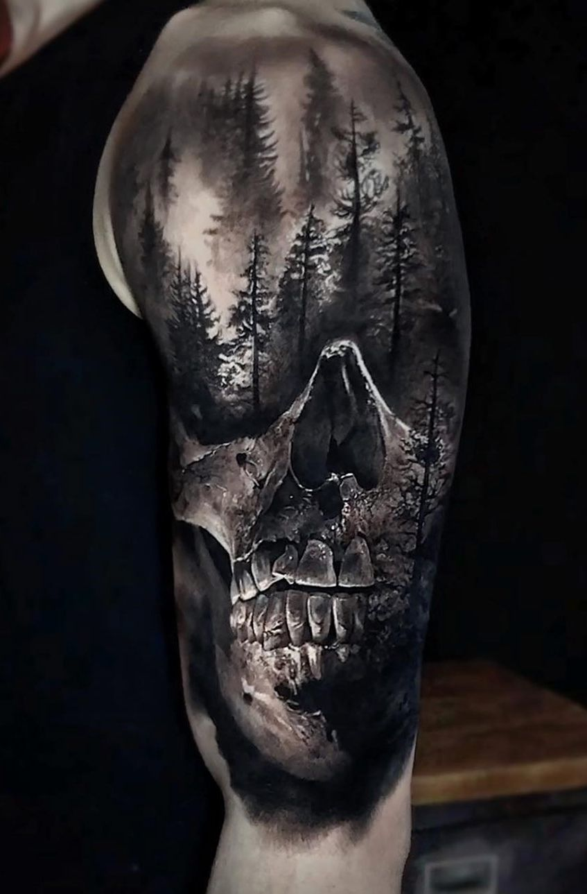 Realistic Skull And Forest Done On Guy S Shoulder Upper Arm Tattoo By Eliot Kohek Skull Sleeve Tattoos Arm Tattoos For Guys Upper Arm Tattoos