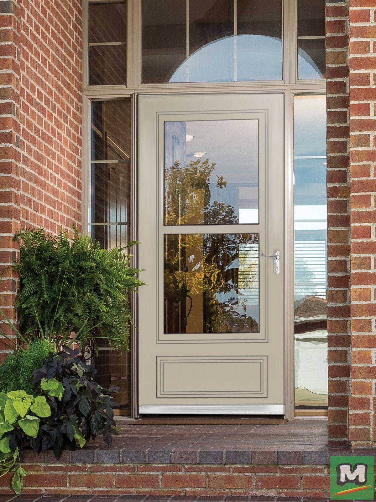 Invite In The Breeze With This Retractable Screen Away Door From Larson Its Functional Glass Desig Exterior House Doors Glass Storm Doors Glass Screen Door