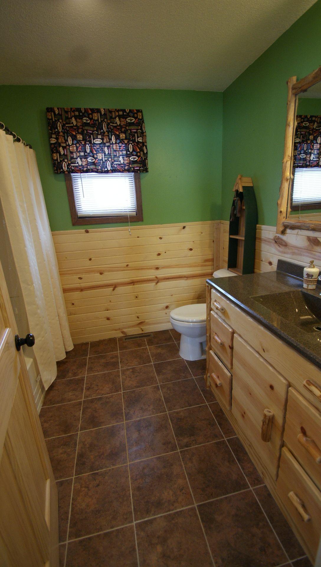 Bathroom with custom log vanity cabin vanity, tile