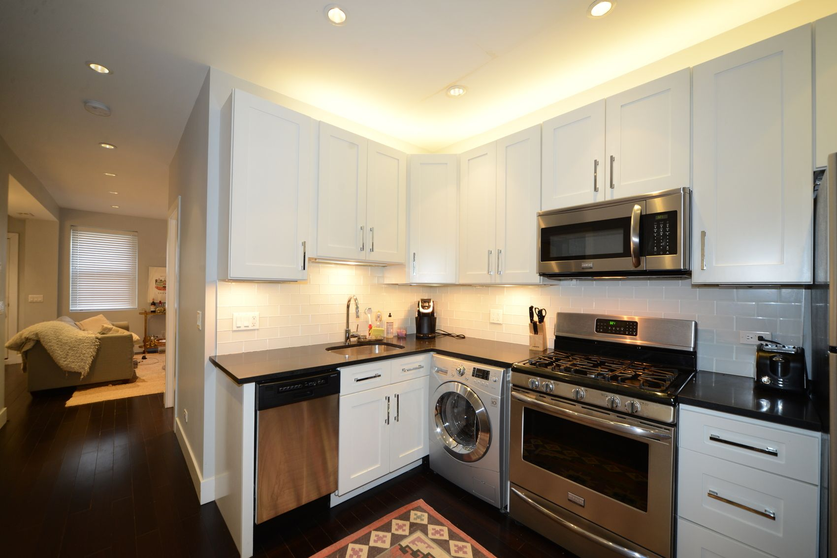 Modern Apartment Kitchen With White Cabinets Stainless Steel