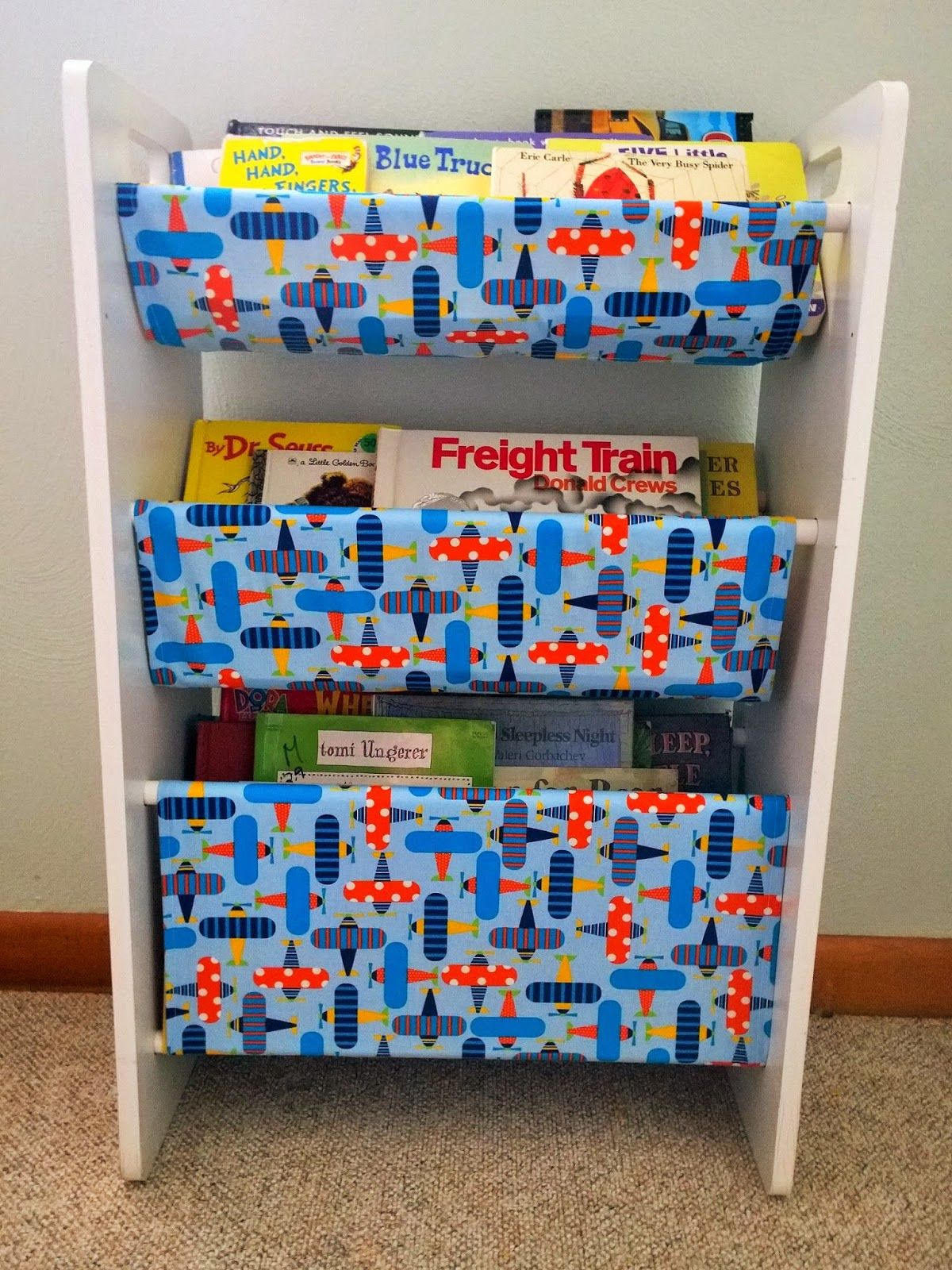 Repurpose An Old Toy Storage Bin Rack Into A Sling Book Rack