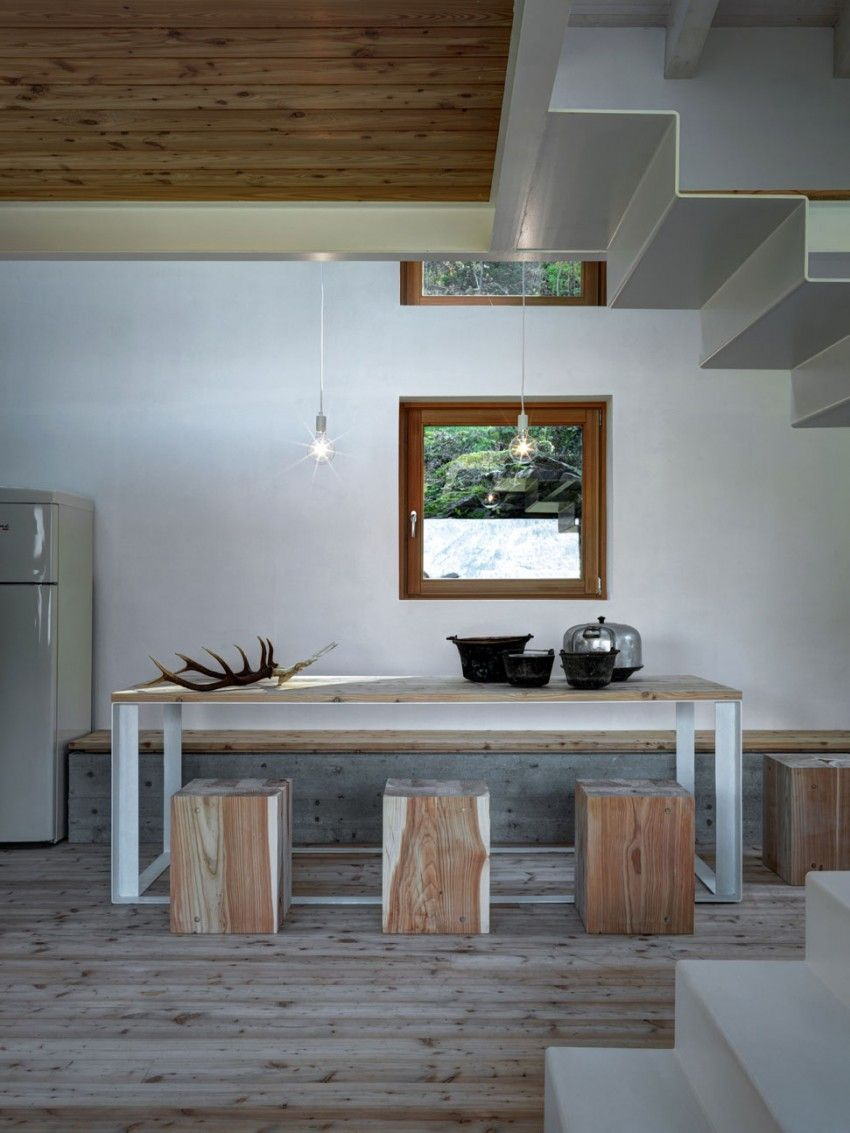 Modern rustic dining room table  Alfredo Vanotti Creates a Home in Piateda Italy that Seamlessly