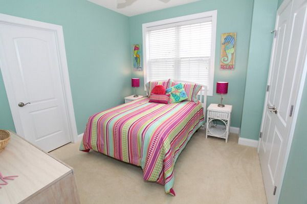 Beach Bedroom Ideas with Soft Green Wall Paints and Sea Animals Wall