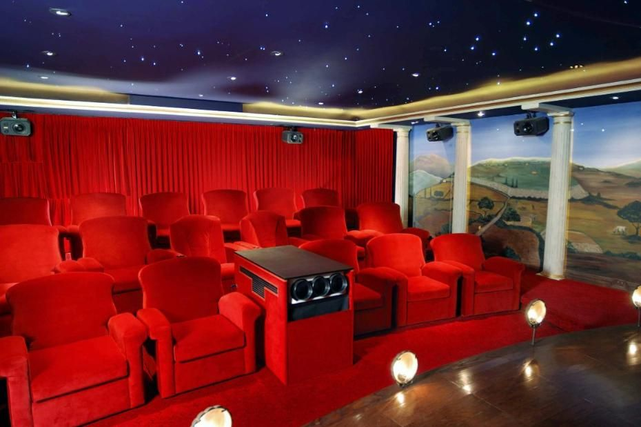 "A home theater in red, with a glittering ""night sky"" ceiling. Discovered on www.Porch.com"