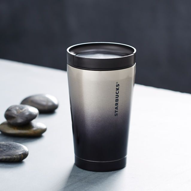 429d3feb704 A double-walled stainless steel tumbler with sliding lid and ...
