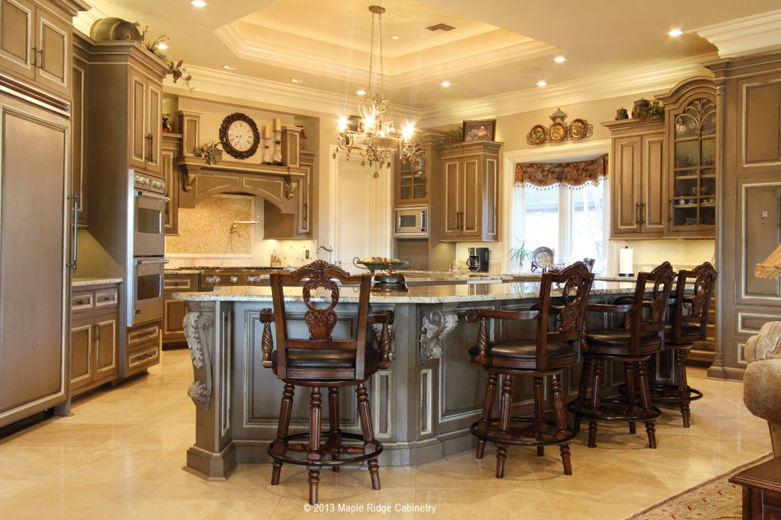 Grand Kitchen features tons of storage and elegant design elements
