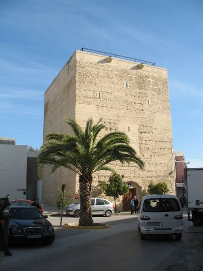 The town of La Rambla has two rammed earth sites, a tower in the centre of the town and a wall which historically encircled the town. The only remaining section of wall is now in a park adjoining the tower. [...] The tower is rectangular in plan (15.3m x 12.8m) and is 17.3m high. There are brick reinforcements at the corners of the tower which are 2.7m thick.