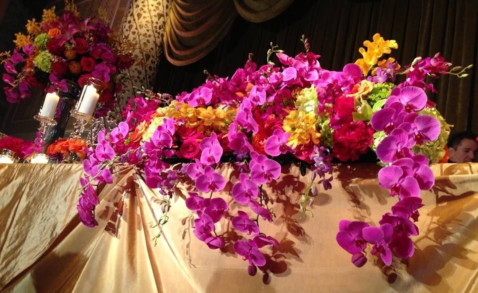 Head table design of mokara, dendrobium phalaenopsis and cymbidium orchids, accompanied by roses. Northern Greenhouses #wedding @ The Drake, Chicago