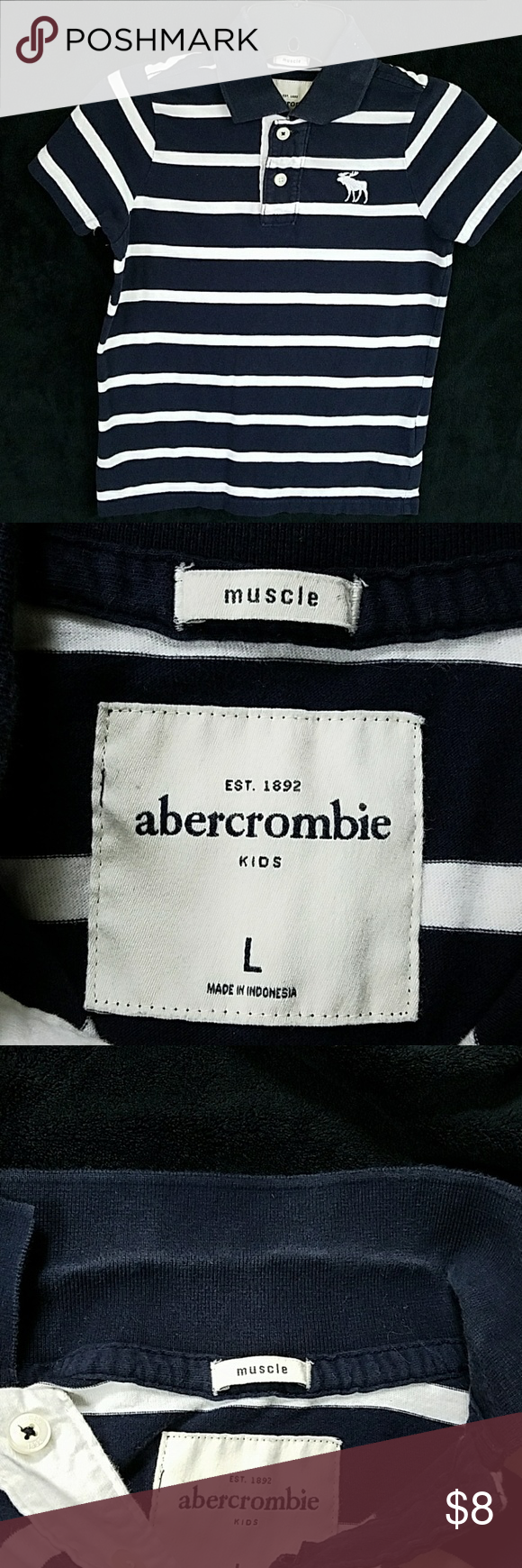 Abercrombie Polo Navy blue striped muscle Abercrombie Polo. Normal wear, a bit of discoloration around the collar as shown in the last picture but cannot be seen when collar is folded down. Abercombie Kids Shirts & Tops Polos