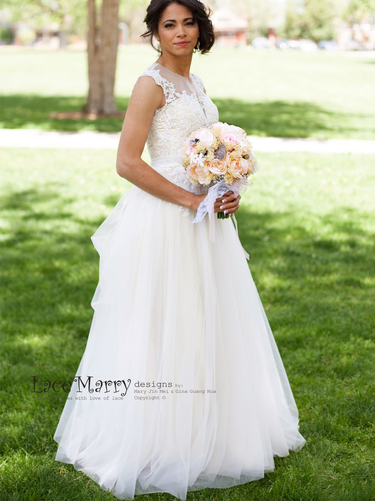 This bohemian wedding dress is made from airy overlay in ivory color