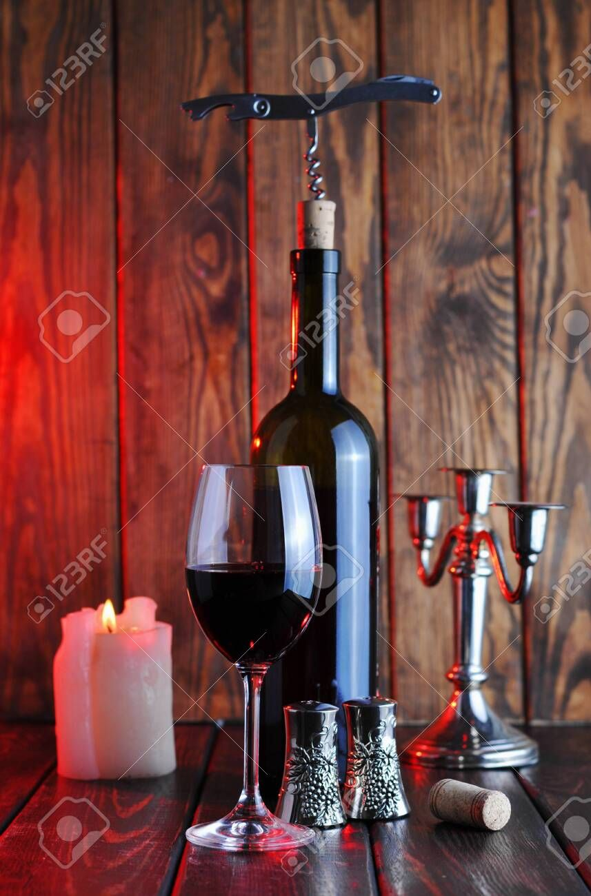 A Glass Of Red Wine With A Bottle And A Candle On A Wooden Background Stock Photo Aff Wine Bottle Glass Red Cand In 2020 Red Wine Glass Wooden Background